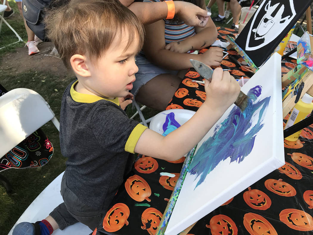 (Hali Bernstein Saylor/Boulder City Review) Kailo Adduci, 3, of North Las Vegas takes his art s ...