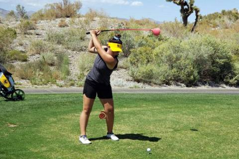 Andy Schaper Boulder City High School senior Makaela Perkins, seen Sept. 23, hits a ball at Bou ...
