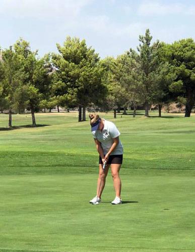 Lou Krumm Boulder City High School senior Sydney Krumm lines up a shot at the Boulder City Golf ...