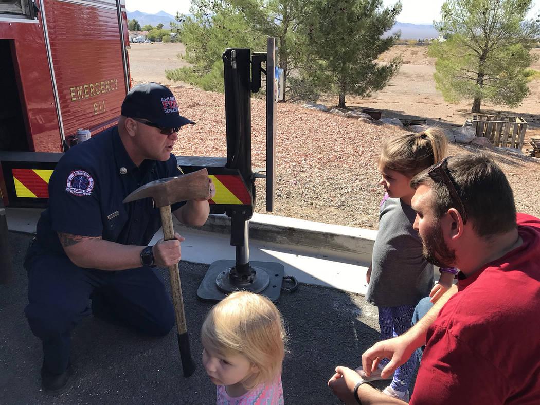 (Hali Bernstein Saylor/Boulder City Review) Boulder City firefighter Walt West, left, explains ...
