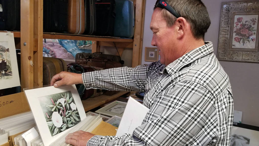 (Celia Shortt Goodyear/Boulder City Review) Jimbo Zinn looks through pieces of art done by the ...