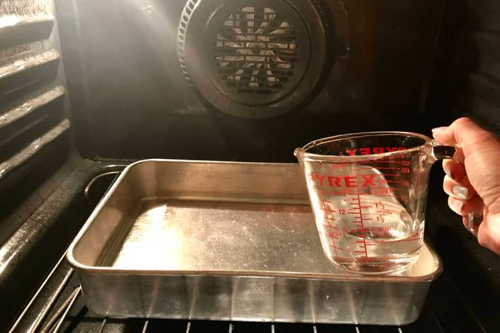 (Norma Vally) Heating a pan of water to create steam will allow you to clean your oven without ...