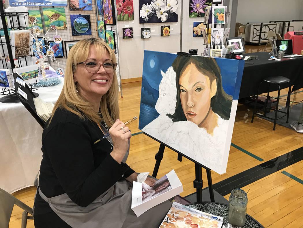 (Hali Bernstein Saylor/Boulder City Review) Sylvia Aldebol demonstrates her painting technique ...