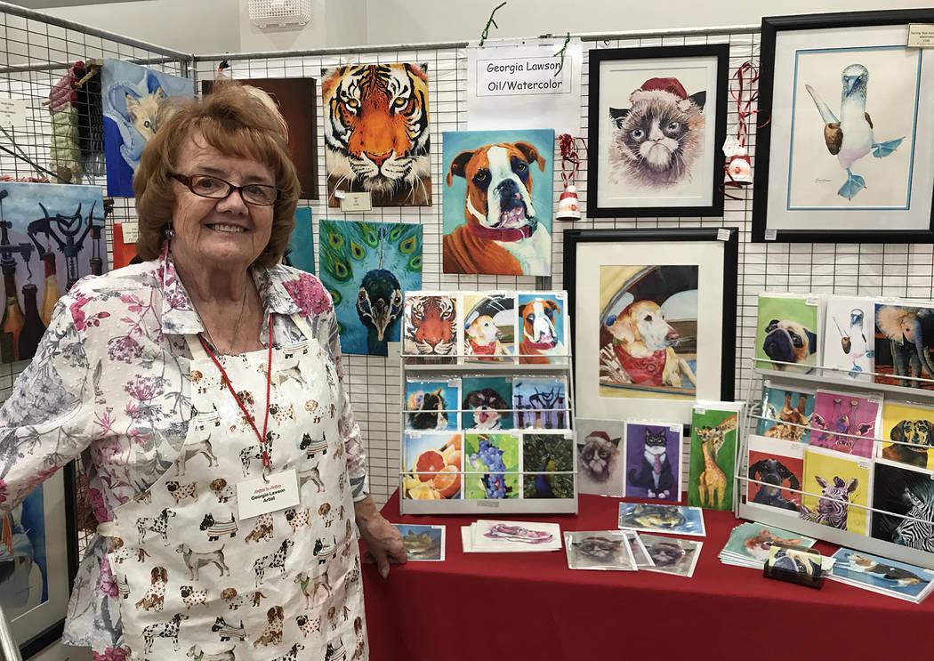 (Hali Bernstein Saylor/Boulder City Review) Georgia Lawson displayed some of the pet portraits ...