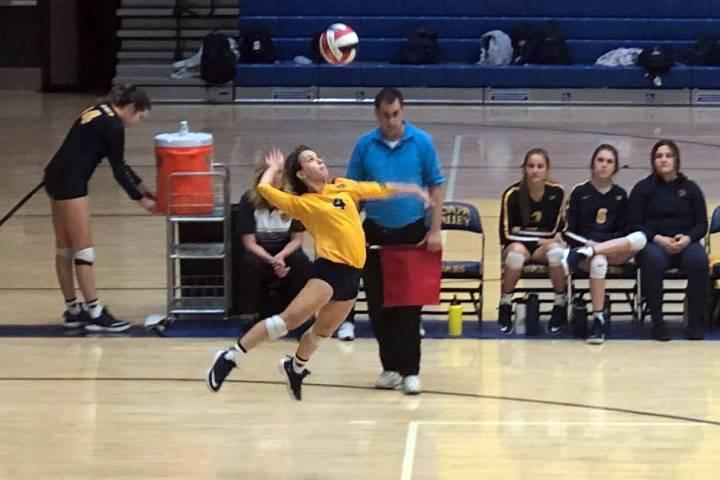 (Boulder City High School) Boulder City High School sophomore Zoey Robinson spikes the ball aga ...