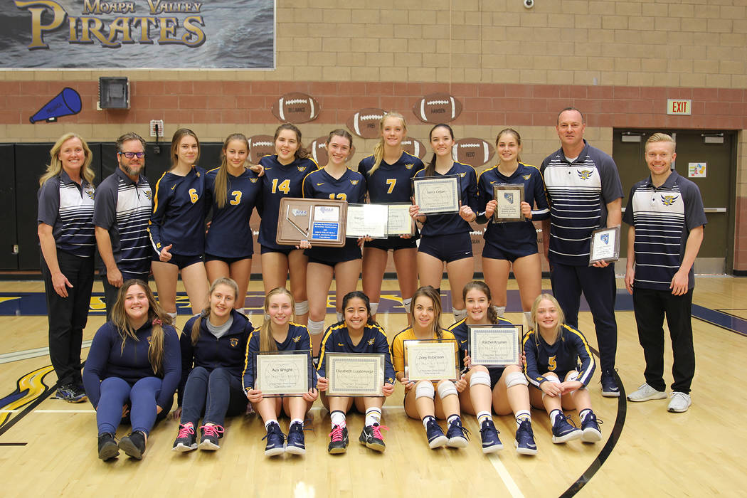 (Cherise Hinman) Members and coaches of Boulder City High School's girls volleyball team cele ...