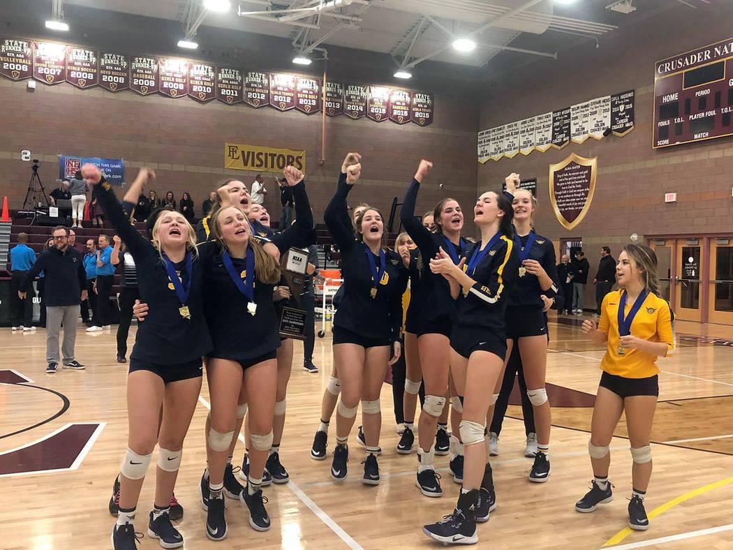 Boulder City High School The Boulder City High School girls volleyball team celebrates its thir ...