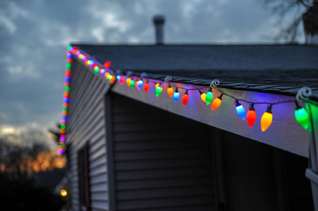 (Norma Vally) When hanging Christmas lights on your home, maintain three-point contact on the l ...