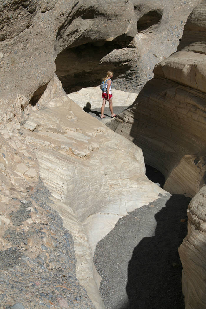 (Deborah Wall) A hiker heads through a narrow section in Mosaic Canyon in Death Valley National ...