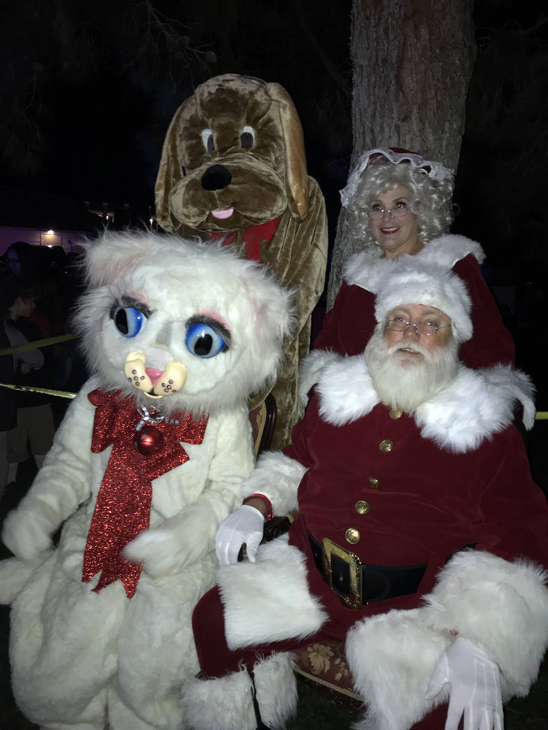 Santa and Mrs. Claus were joined by Jingle Cat and Hoover the Dam Dog for the 2018 Christmas tr ...