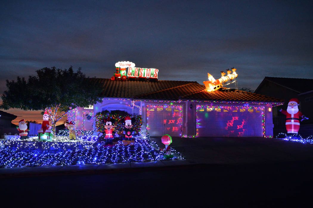 (Celia Shortt Goodyear/Boulder City Review) The home at 796 Los Tavis Way features inflatable d ...