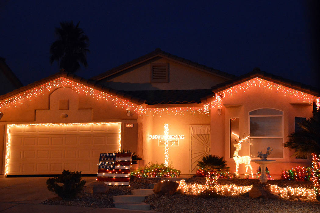 (Celia Shortt Goodyear/Boulder City Review) Twinkling lights along with religious and patriotic ...