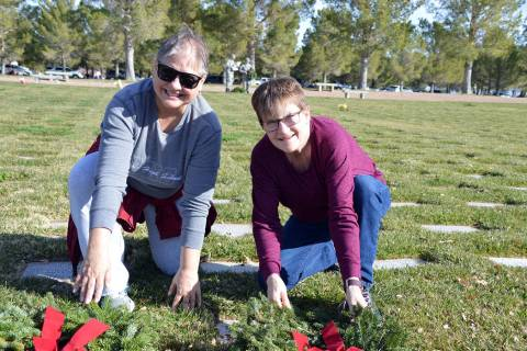 Celia Shortt Goodyear/Boulder City Review Lila Bair, left, and Kolleen Stolte lay wreaths on th ...