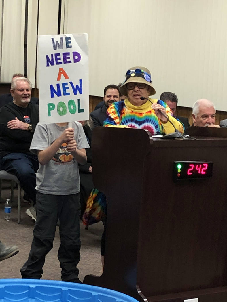 Boulder City Jan Miller and her grandson showed their support for a new pool during the Feb. 26 ...