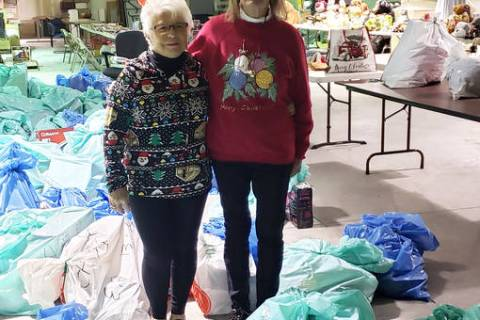 (Emergency Aid of Boulder City) Emergency Aid of Boulder City distributed Christmas gifts from ...