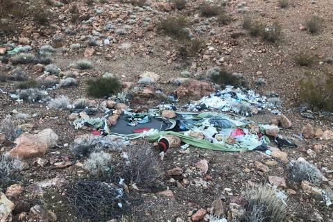 (Ed Knapp) The remains of a tent and discarded bottles are among the debris left by homeless pe ...