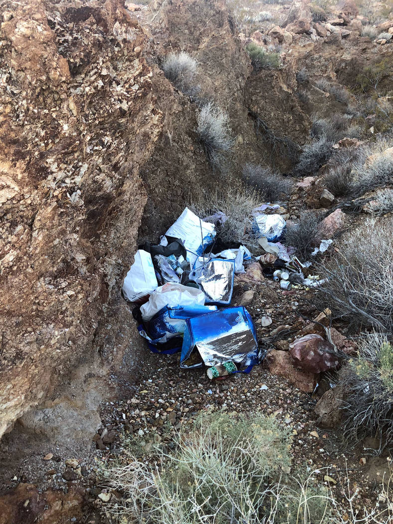 (Ed Knapp) The remains of a homeless camp in Bootleg Canyon features rotting debris and old ins ...