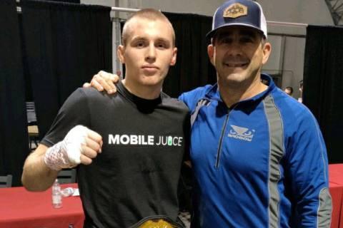 (Kim Cox) Octavian Trumbo, left, who wrestled at Boulder City High School, celebrates his title ...