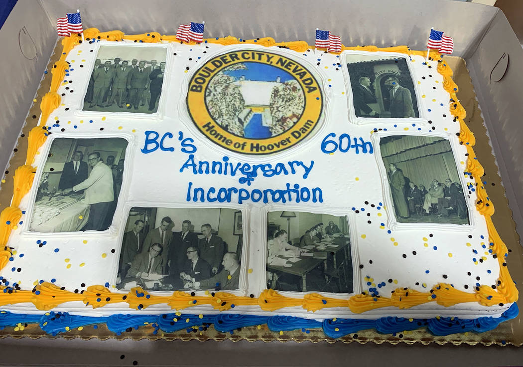 (Hali Bernstein Saylor/Boulder City Review) A cake featuring pictures from the early days of Bo ...
