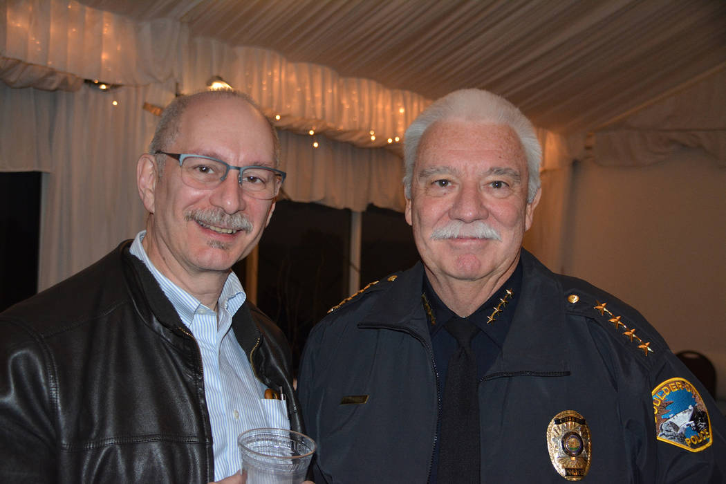Celia Shortt Goodyear/Boulder City Review John Cermenaro, left, talks with Boulder City Police ...