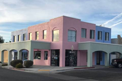(Paradise Found Plaza) Pink, blue and green sherbet colors now accent the exterior of Paradise ...