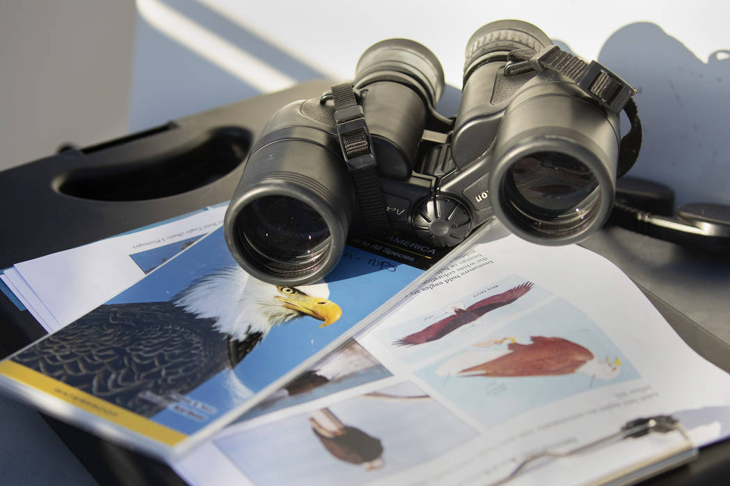 (Ellen Schmidt/Las Vegas Review-Journal) Materials to find and identify eagles sit on the boat ...