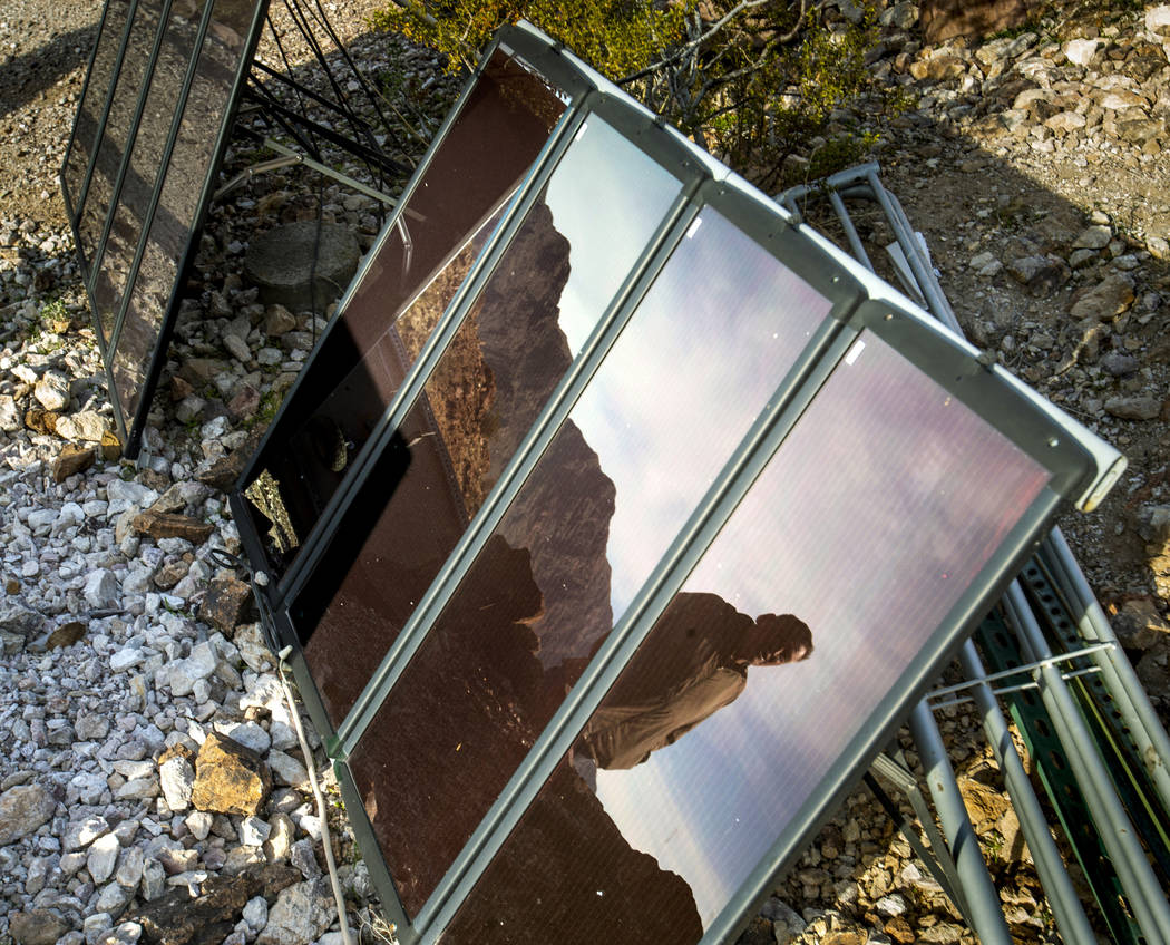 (L.E. Baskow/Las Vegas Review-Journal) Richard Roman is reflected in one of his solar panels as ...