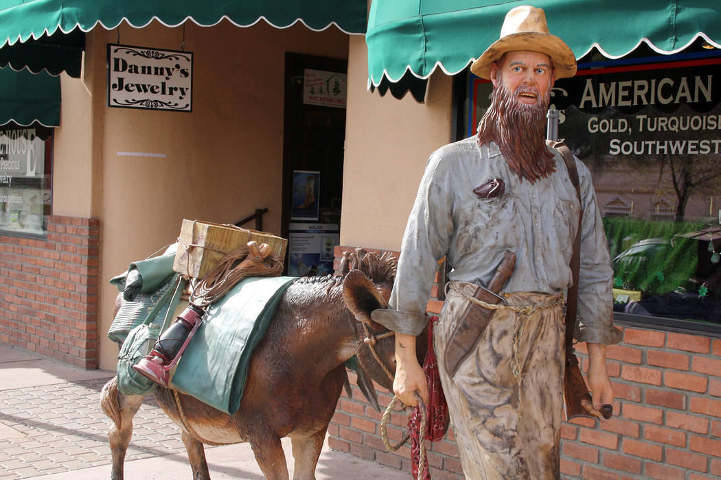 (Deborah Wall) A statue of a miner leading his burro during the mining boom in the 19th century ...