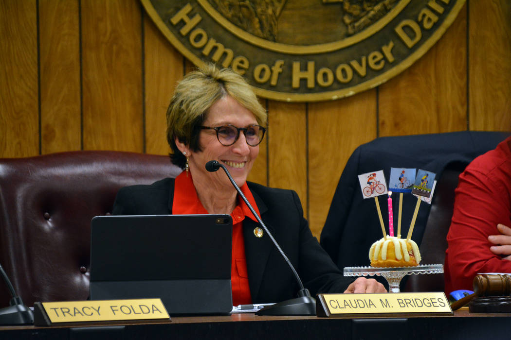 (Celia Shortt Goodyear/Boulder City Review) Councilwoman Claudia Bridges is presented with a ca ...