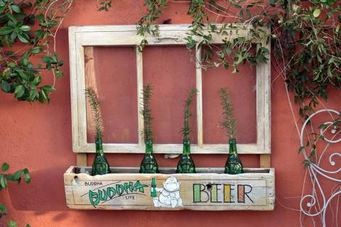 (Norma Vally) Old window frames can be repurposed into wall or garden accents, especially when ...