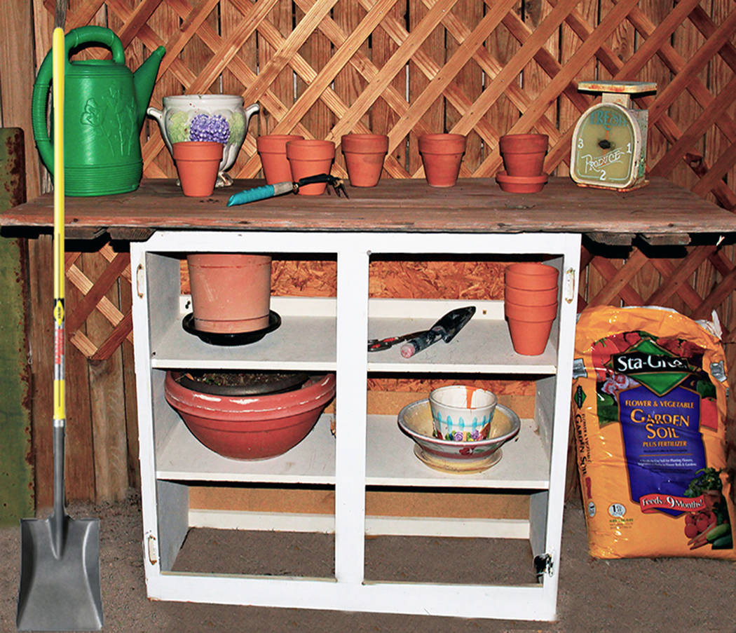 (Norma Vally) An old cabinet with the door removed can be upcycled into a potting table for the ...
