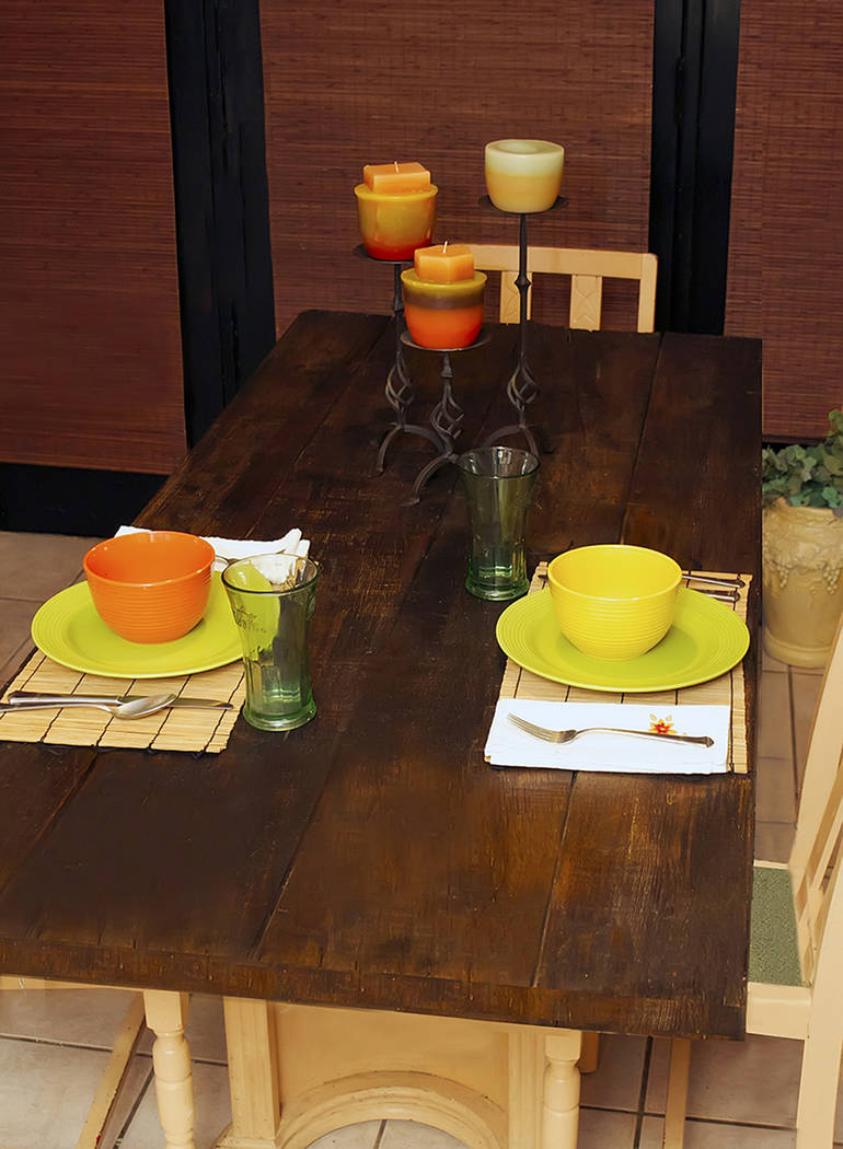 (Norma Vally) Transform an old wood door into a dining table with a fresh coat of stain before ...