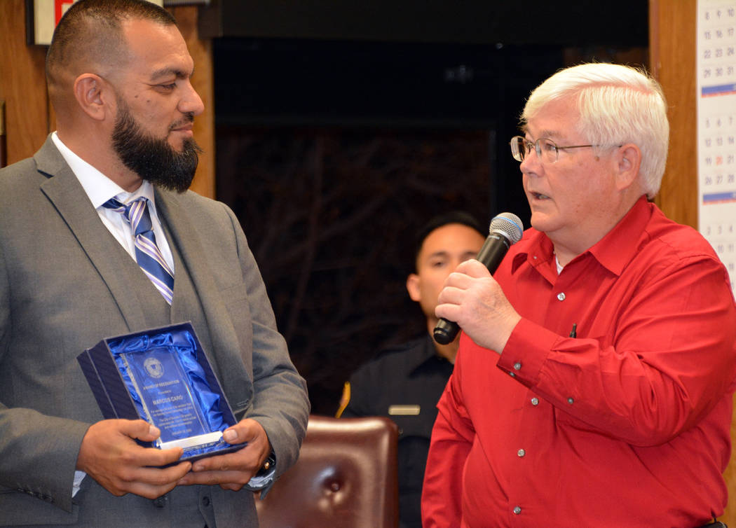 (Celia Shortt Goodyear/Boulder City Review) Marcos Caro, left, is given an award at the Jan. 28 ...
