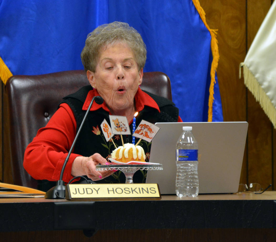 (Celia Shortt Goodyear/Boulder City Review) Councilwoman Judy Hoskins blows out the candles on ...