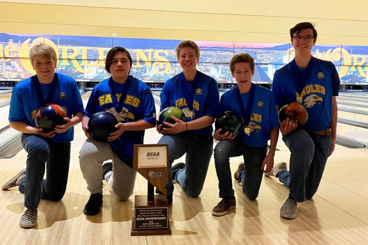 (Amy Wagner) Members of the boys bowling team from Boulder City High School celebrate winning t ...