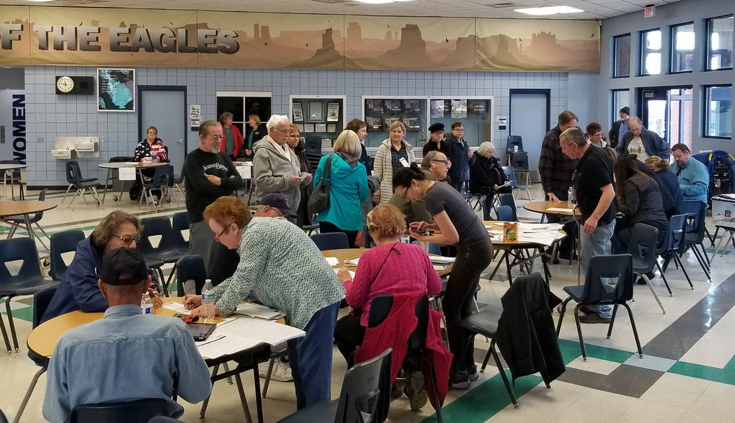 Celia Shortt Goodyear/Boulder City Review Voters line up to register at the Democratic caucus S ...