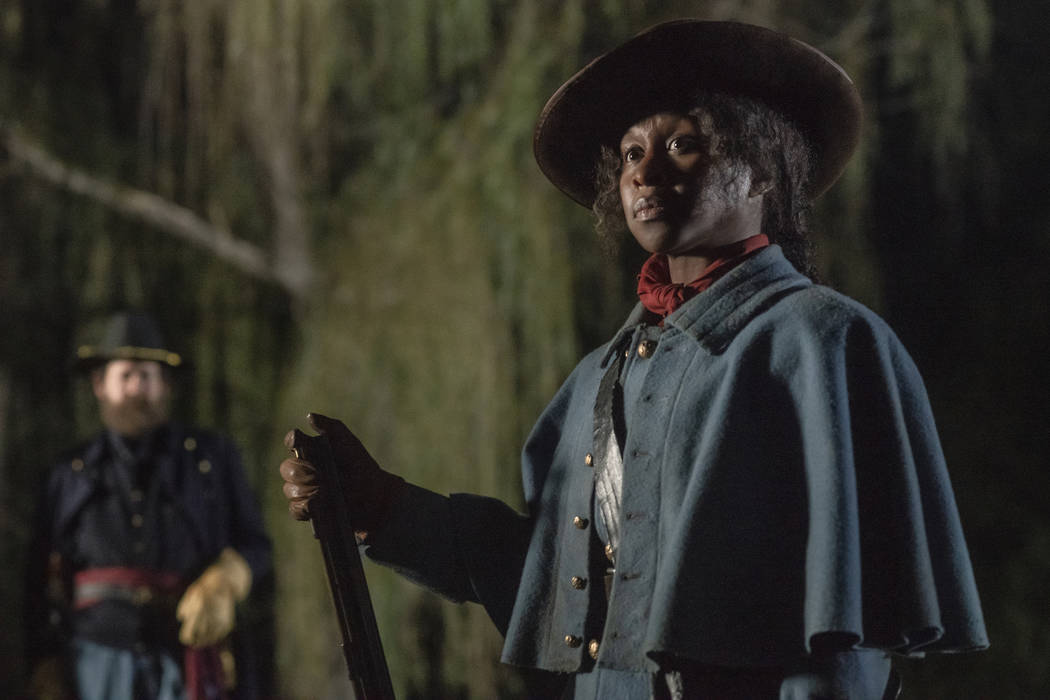 "Cynthia Erivo stars as Harriet Tubman in a scene from ""Harriet,"" which will be show ..."