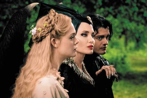 Elle Fanning is Aurora, Angelina Jolie is Maleficent and Sam Riley is Diaval in Disney's live ...