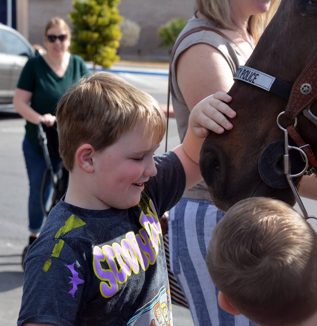 (Celia Shortt Goodyear/Boulder City Review) Jackson Mack pets Star, a horse with the Boulder Ci ...