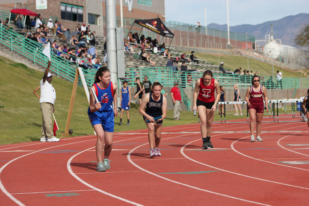 (Mark Misuraca) Boulder City High School sophomore Mary Henderson, second from left, led of 4x8 ...