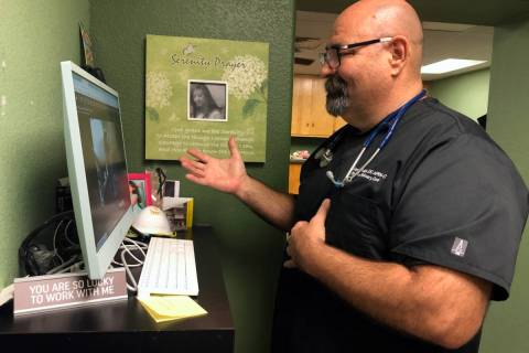 (Dr. Larry Smith) Dr. Larry Smith conducts a telehealth appointment with a patient at Boulder P ...