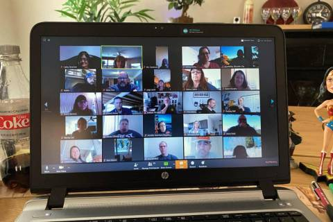 Amy Wagner Boulder City High School teachers utilize Zoom for their faculty meetings while the ...