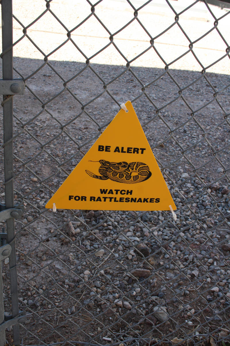 (Deborah Wall) Signs help remind outdoor enthusiasts to be on the look out for rattlesnakes, wh ...