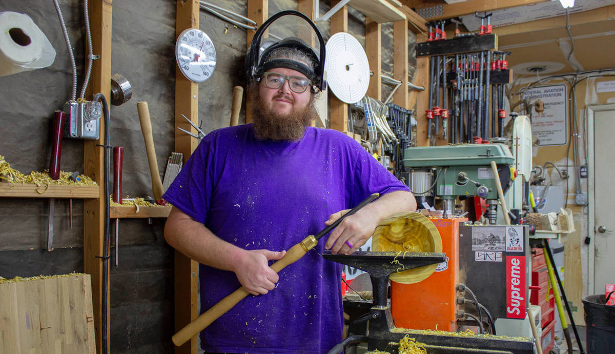 (Braxton Wirthlin) Braxton Wirthlin of Boulder City stands by his lathe, which he uses to trans ...