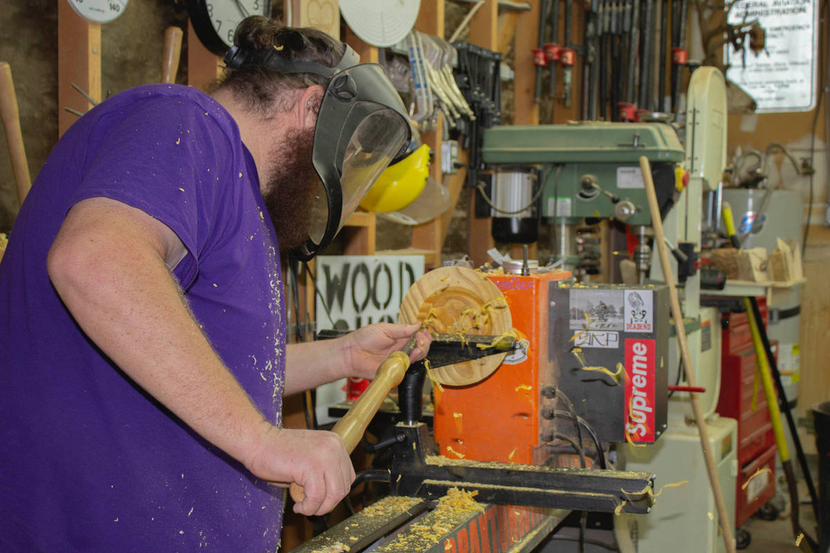 (Braxton Wirthlin) Braxton Wirthlin of Boulder City uses a lathe to transform pieces of reclaim ...
