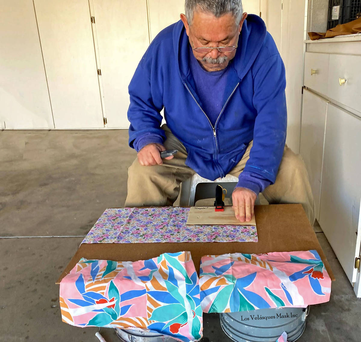 (Jesus Velasquez) Jesus Velasquez of Boulder City cuts material to be made into masks for the S ...
