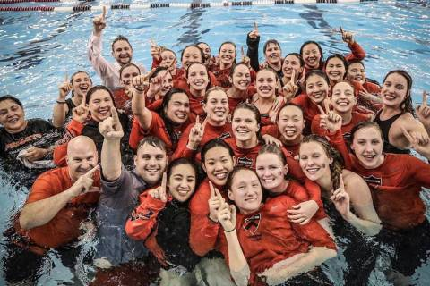 (Bret Lundgaard) Bret Lundgaard, in back at left, Princeton University's head swim coach ...