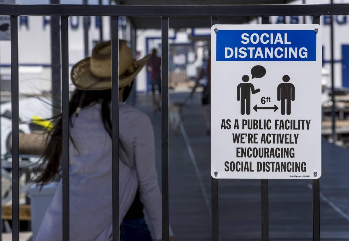 (L.E. Baskow/Las Vegas Review-Journal) A social distancing sign greets visitors at the Las Vega ...
