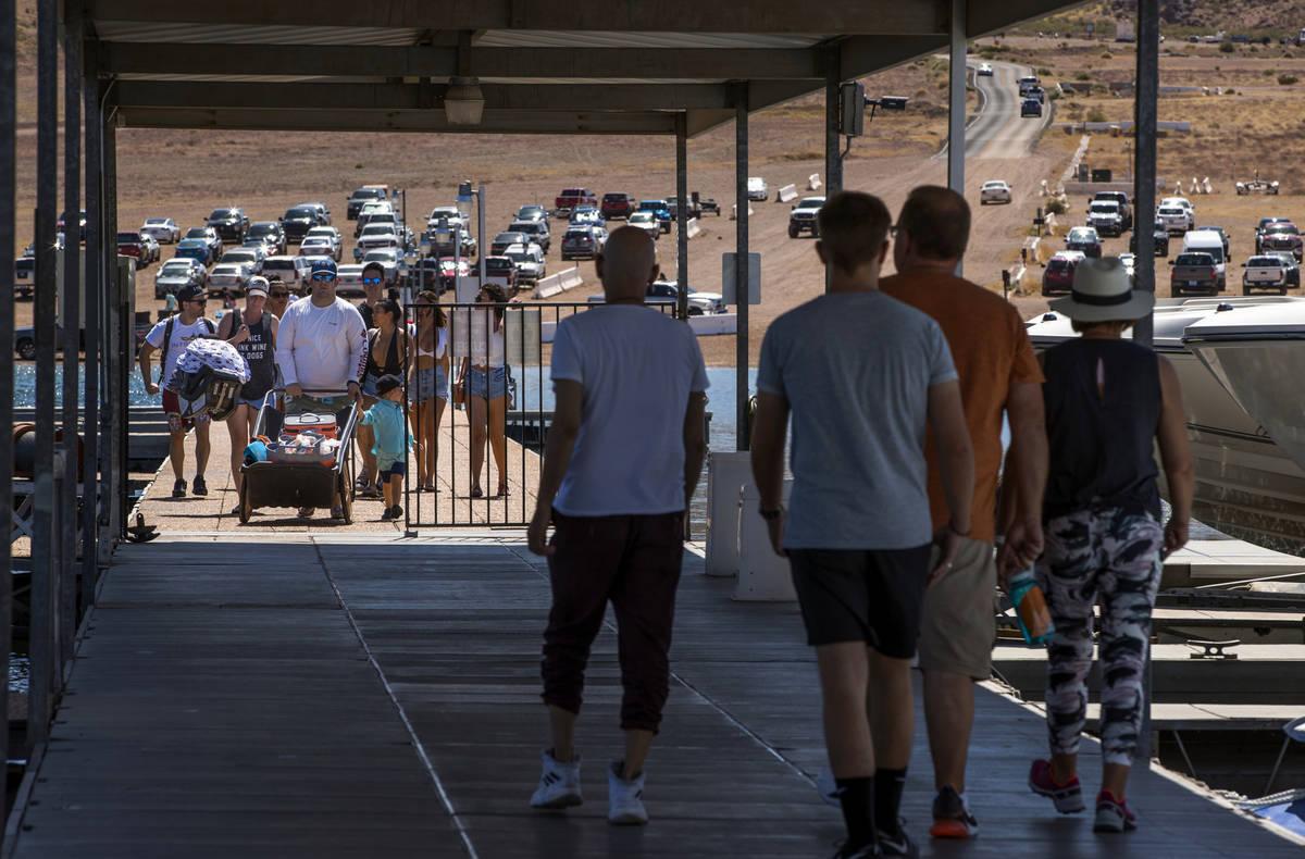 (L.E. Baskow/Las Vegas Review-Journal) Visitors walk on the pier at the Las Vegas Boat Harbor i ...