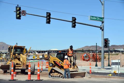 Celia Shortt Goodyear/Boulder City Review Workers with William Charles Construction repave the ...